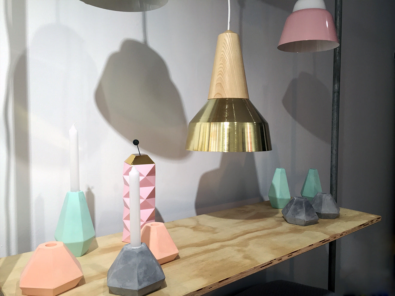concrete candle holders and modern lighting designs a splash of colour UK