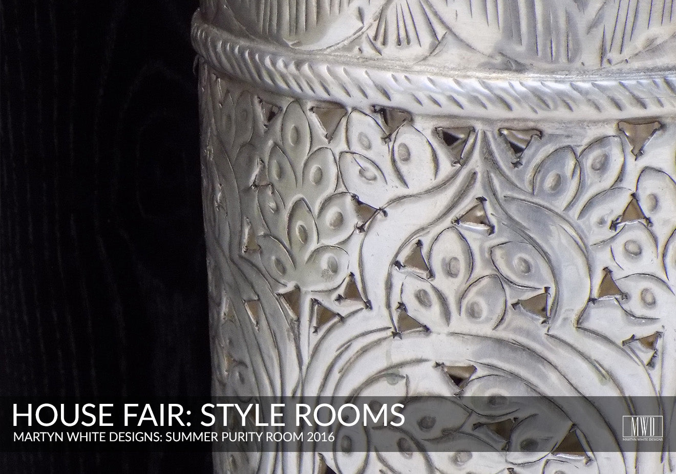 Metal detailing of Lombok umbrella stand on display at the House Fair