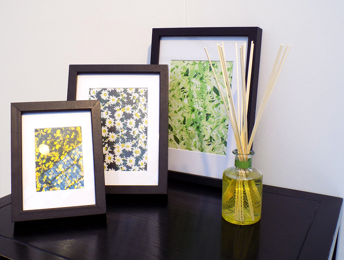 Summer flowers artwork in black frames with true grace scented diffuser