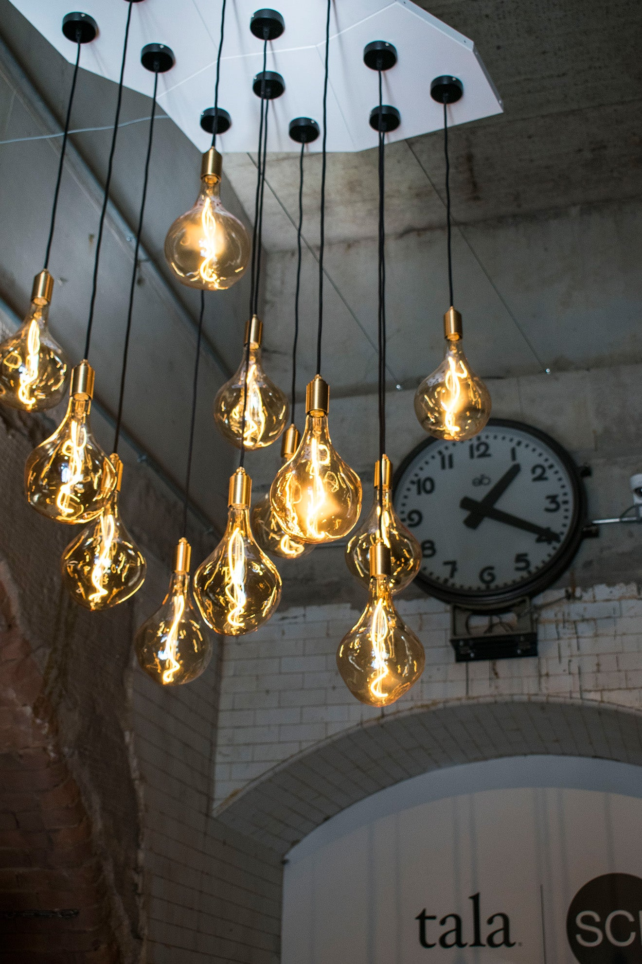 Tala Lighting pendant designs with LED filament under the arches for London Design Festival with SCP