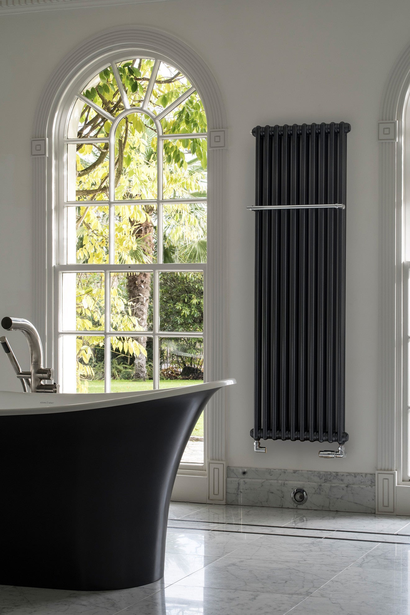 Luxury bathroom tall black radiator from Bisque radiators