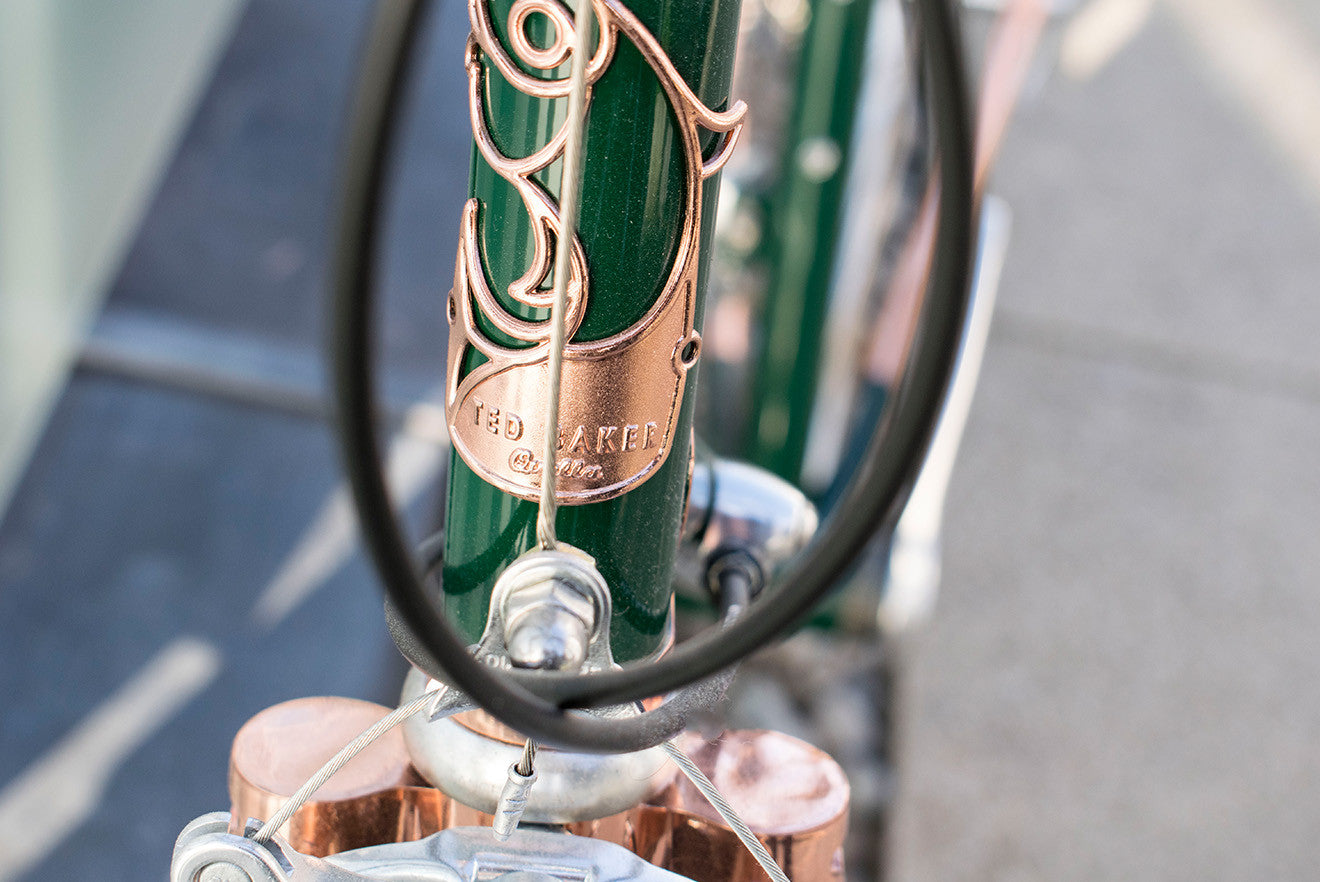 Ted Baker green and copper colour bike