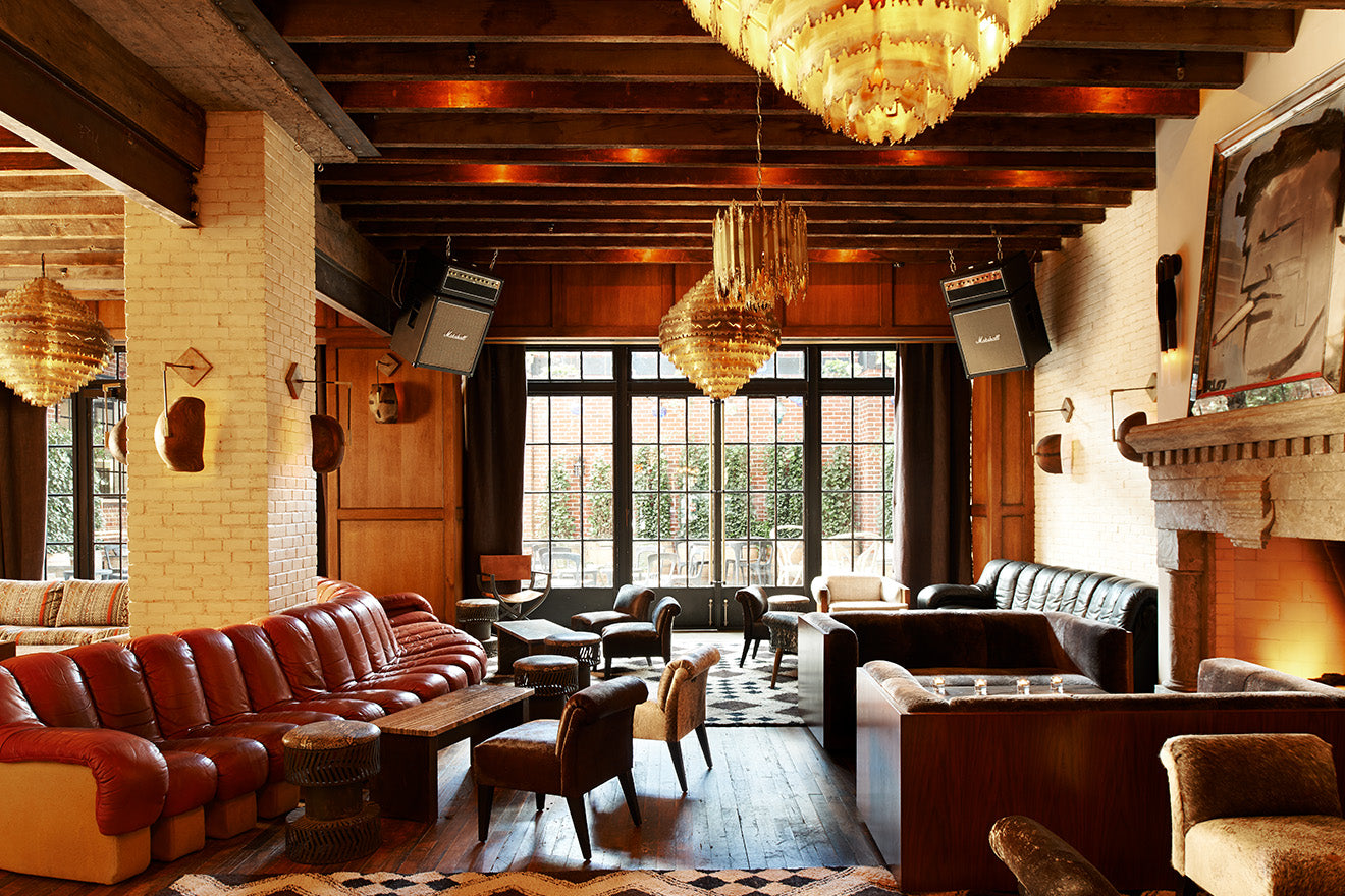 Ludlow hotel lounge and bar area with rustic vintage decor and fireplace