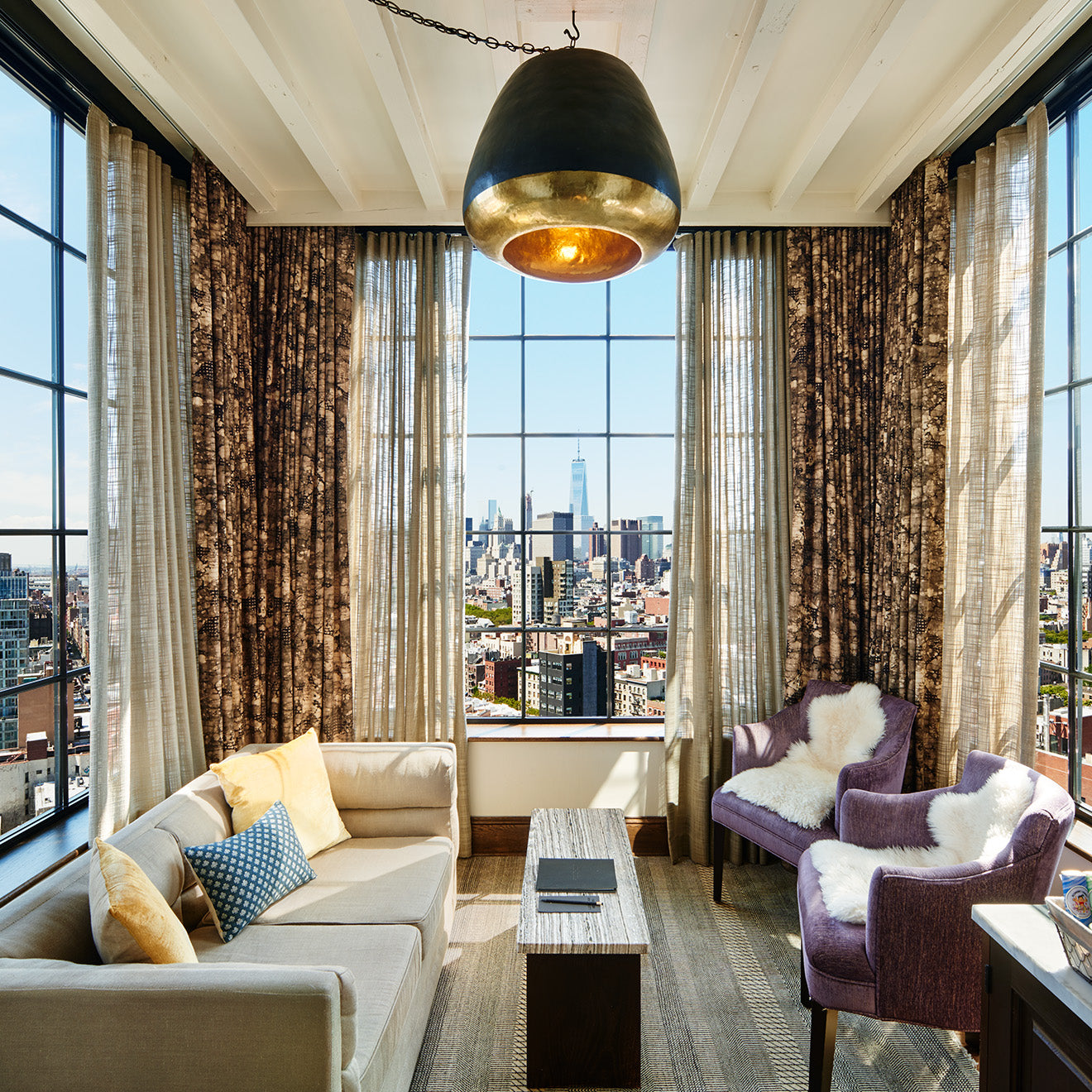 Sky Loft at the Ludlow Hotel in New York with 180 views across the city and Manhattan skyline