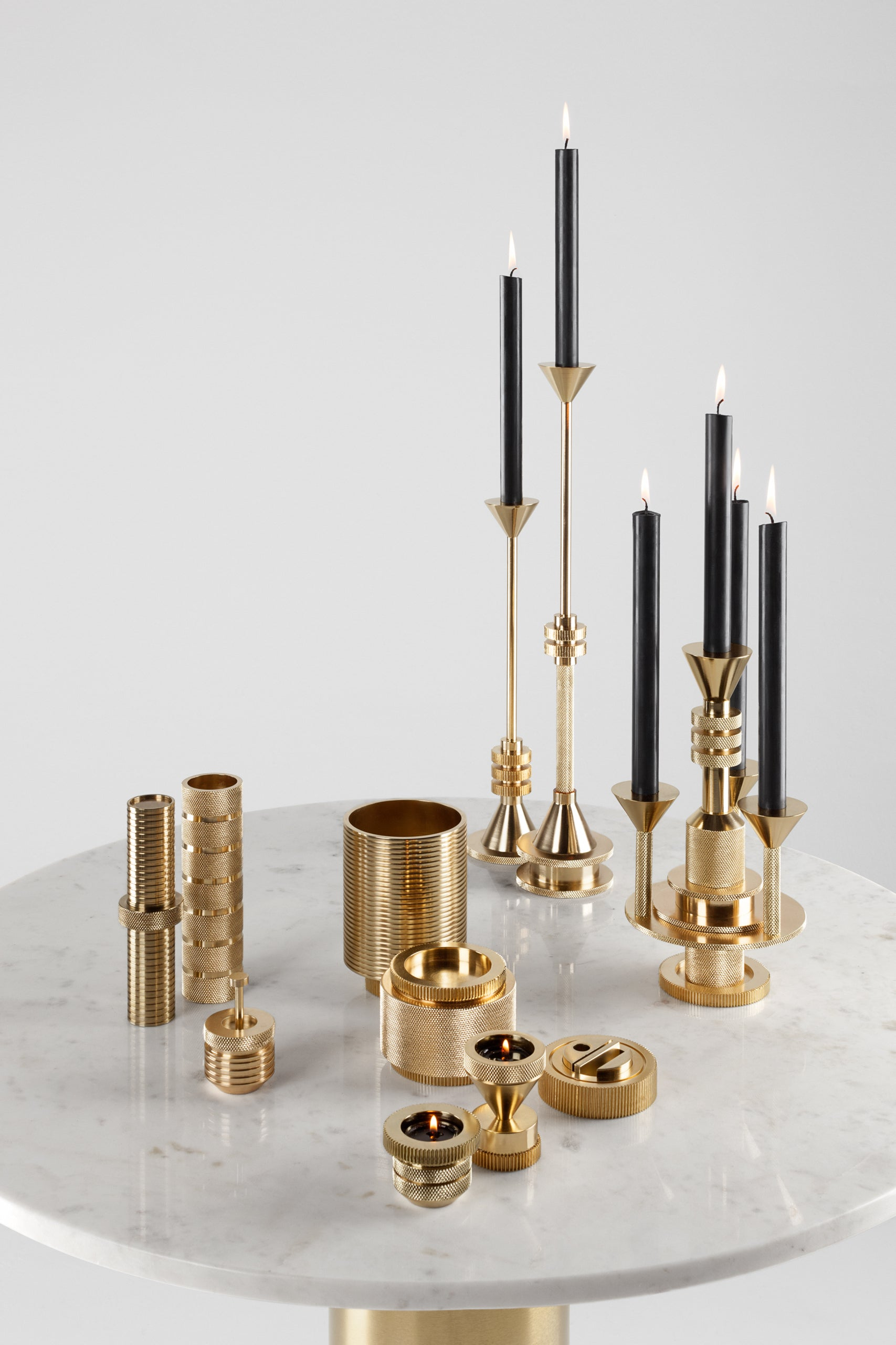 Tom Dixon Cog brass candlestick collection