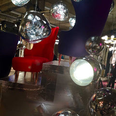 Tom Dixon Wingback chair and mirror ball lighting