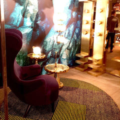 Tom Dixon Brass spun side tables and purple wingback chair