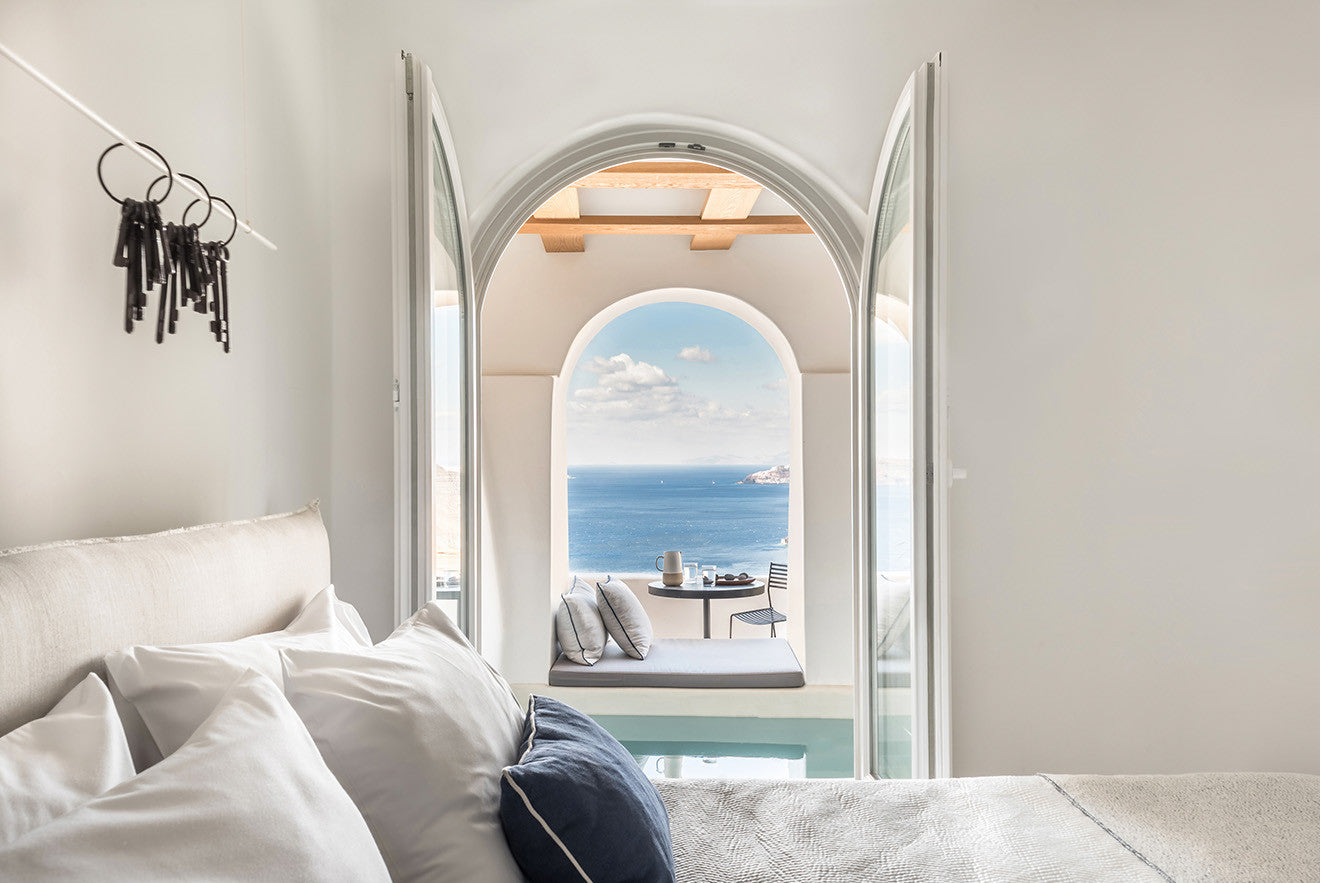 views from the bedroom out across the terrace and sea - Laboratorium designs the beautiful Porto Fira Suites in Santorini