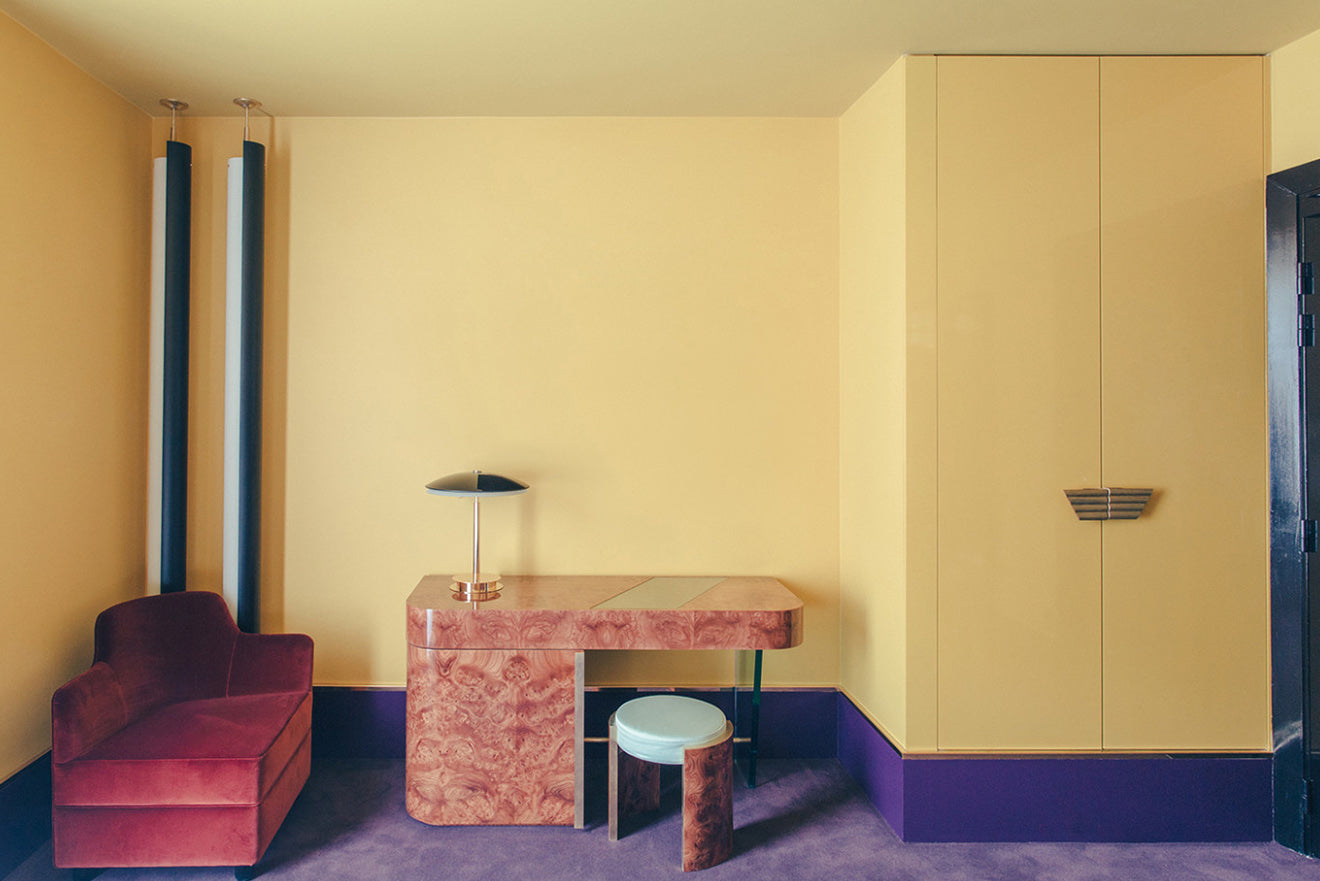 Yellow and purple retro style hotel room