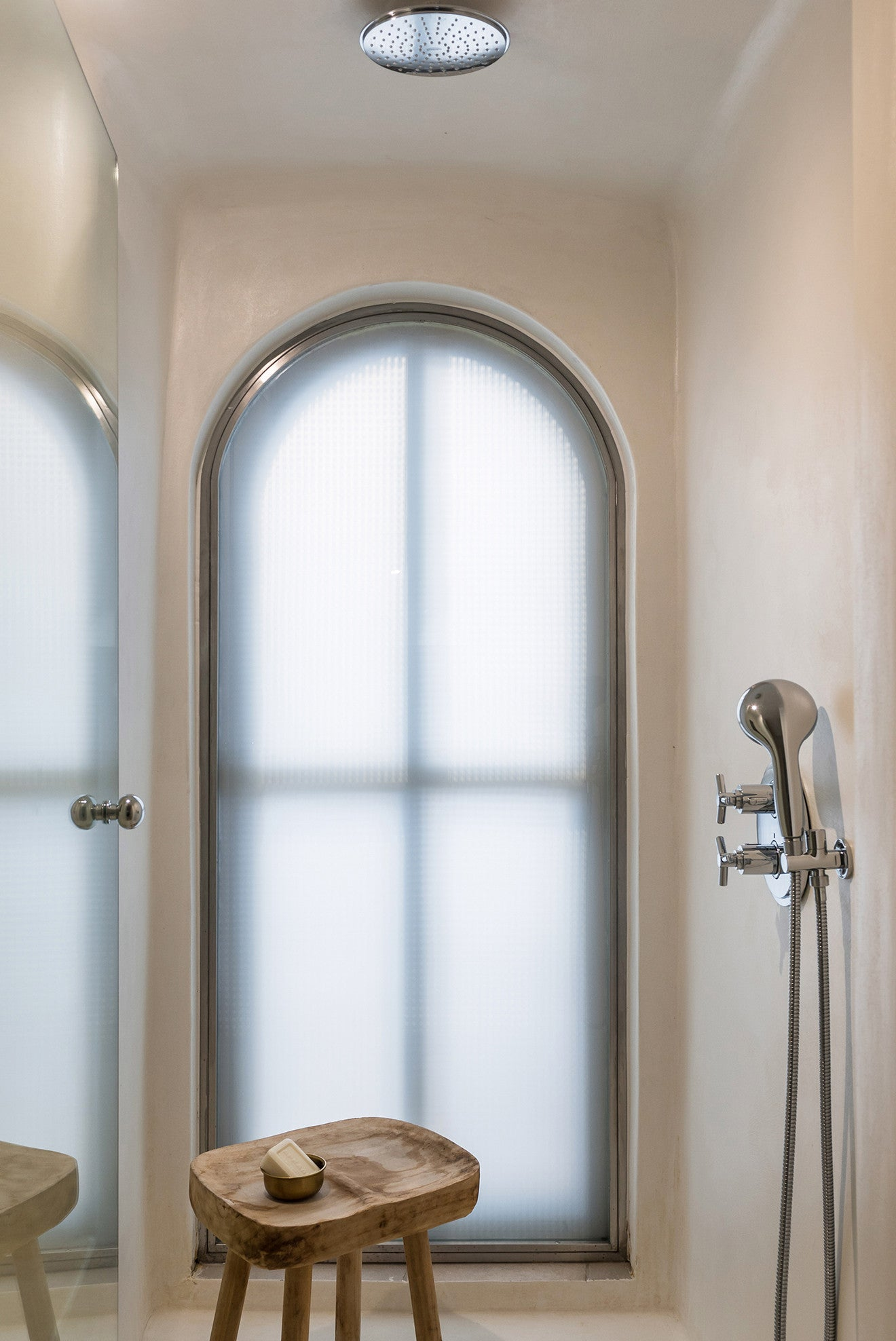 Shower room with frosted arched window - Laboratorium designs the beautiful Porto Fira Suites in Santorini