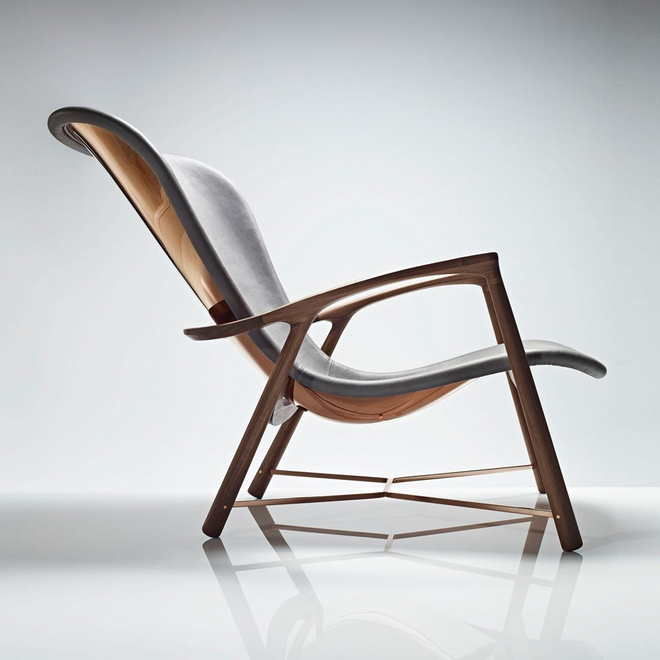 LINLEY luxury furniture designs Silhouette chair with copper back.