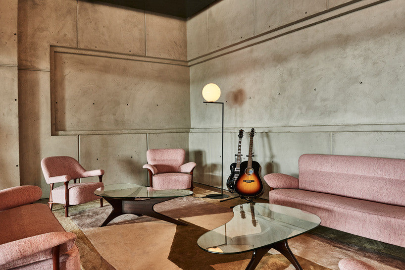 Spring Place membership luxury studio lounge space with pink upholstered lounge chairs