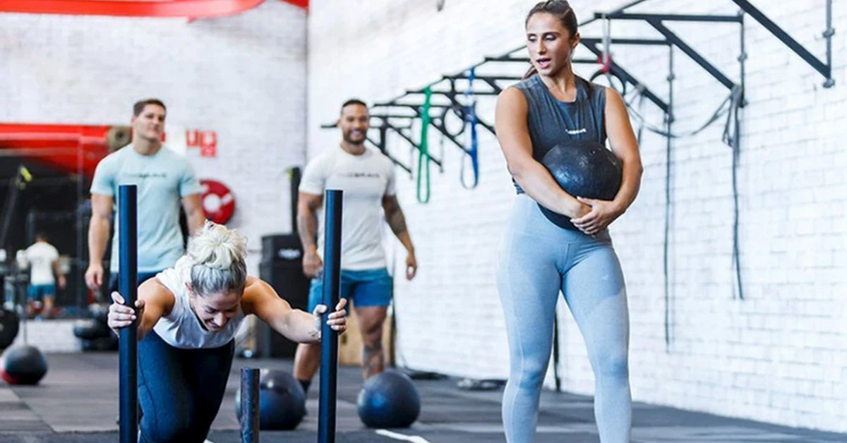 women training at the gym