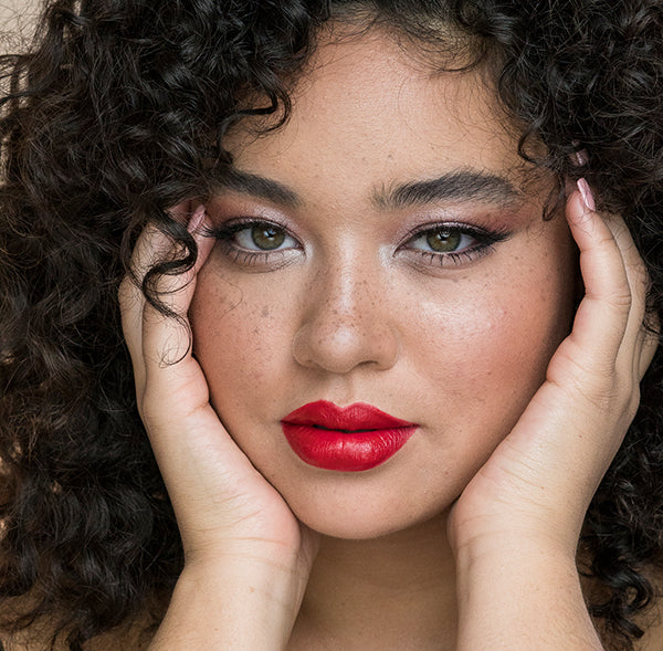 Model wearing Red Shimmer lipstick all natural creamy formulation