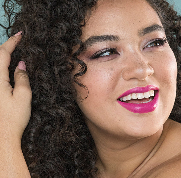 Model wearing Fuschia Shock all natural lipstick