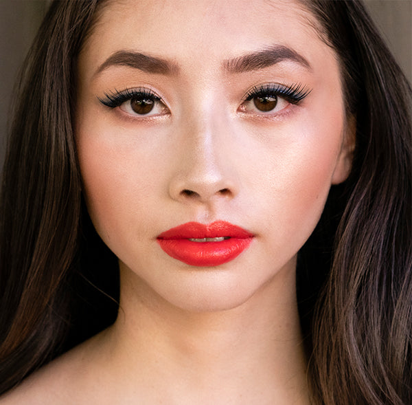 Model wearing #12 Rymba Rhythm Lipstick shade