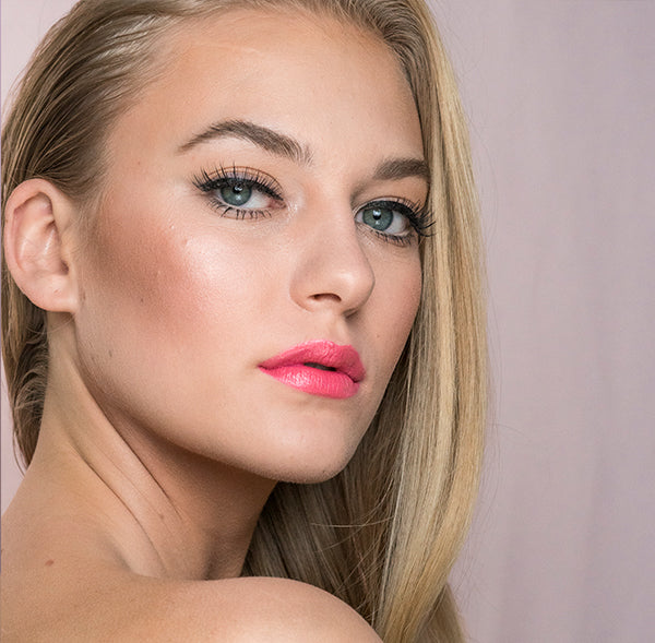 Model wearing Poppy Passion natural lipstick