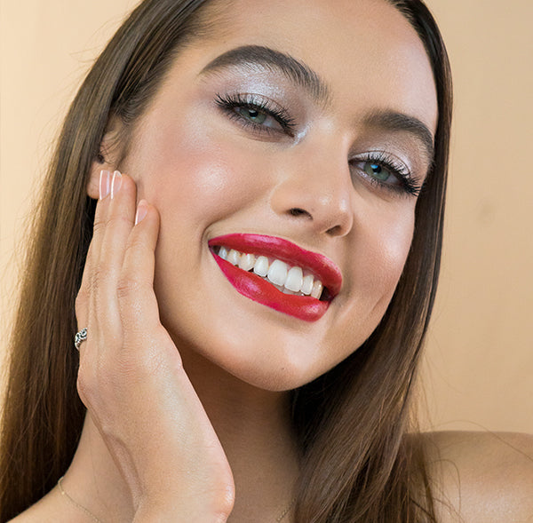 Model wearing #20 True Love natural lipstick