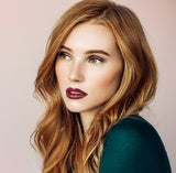 Model wearing #22 Bordeaux Rouge moisturising lipstick