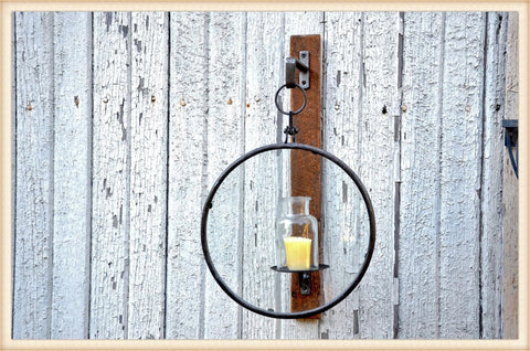 Glass ring wall mounted candle holder