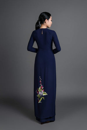 Women's ao dai dress Vietnamese traditional long tunic. High quality navy colored fabric with beautiful embroidered motif.