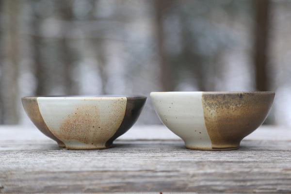 Two tri-colored small bowls