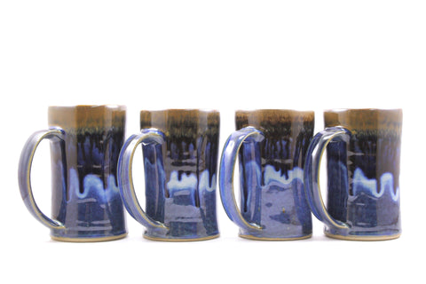 Four mugs in deep blue glaze