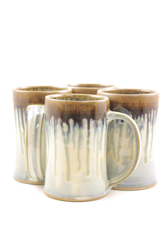 Four mugs in light blue glaze