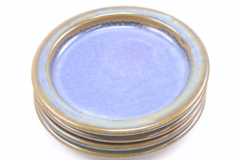 Four cake plates in deep blue glaze