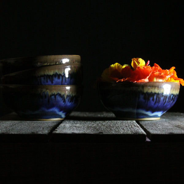 Four small bowls in deep blue glaze