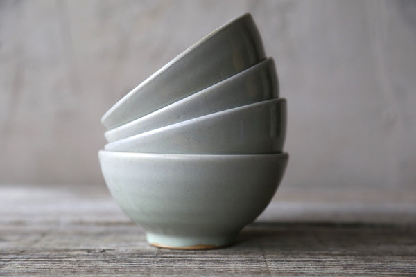 Four small bowls in earthy glaze