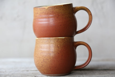 Pair of mugs in rust glaze