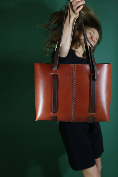 The Weekday tote in Cherrywood Red steerhide