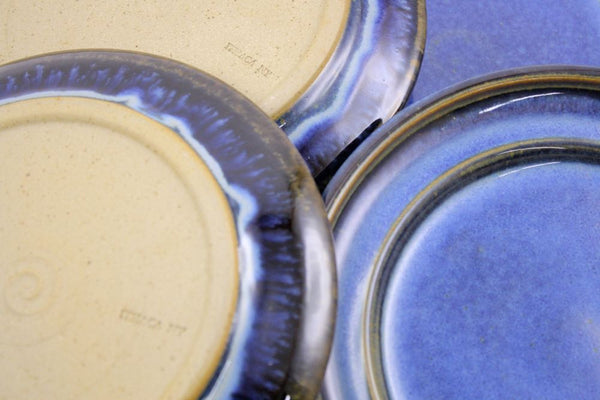 Four salad plates in deep blue glaze