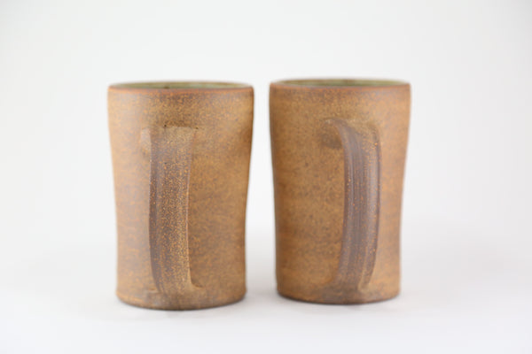 Pair of speckled bare clay mugs