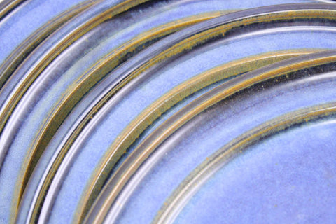 Four dinner plates in deep blue glaze