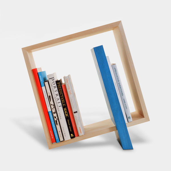 Q Bookframe in maple with blue leg shown holding books