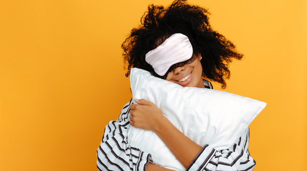woman holding pillow sleeping