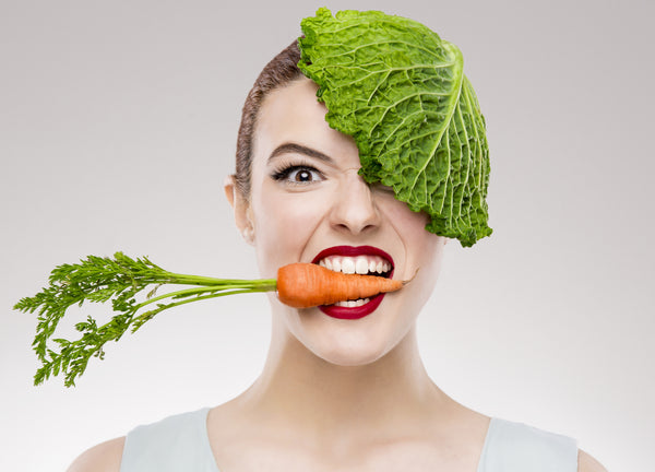 woman with carrot in mouth