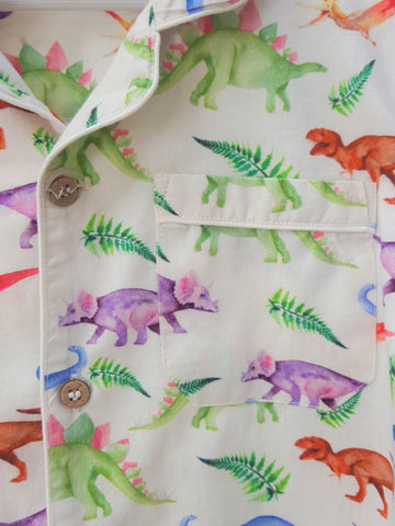 Dinosaur print button thru PJs. The Little Owl's Nest Children's Clothing