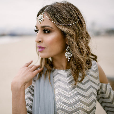 indian girl wearing jewellery on beach