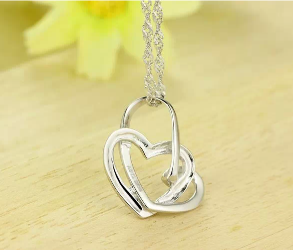 Elegant Heart Shaped Diamond Pendant  in Sterling Silver