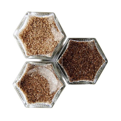 Three infused salts for grilling in a magnetic spice rack