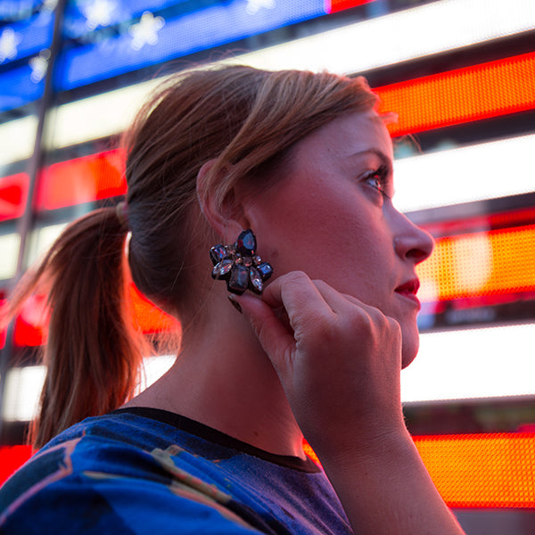 Woman wearing statement earrings in New York