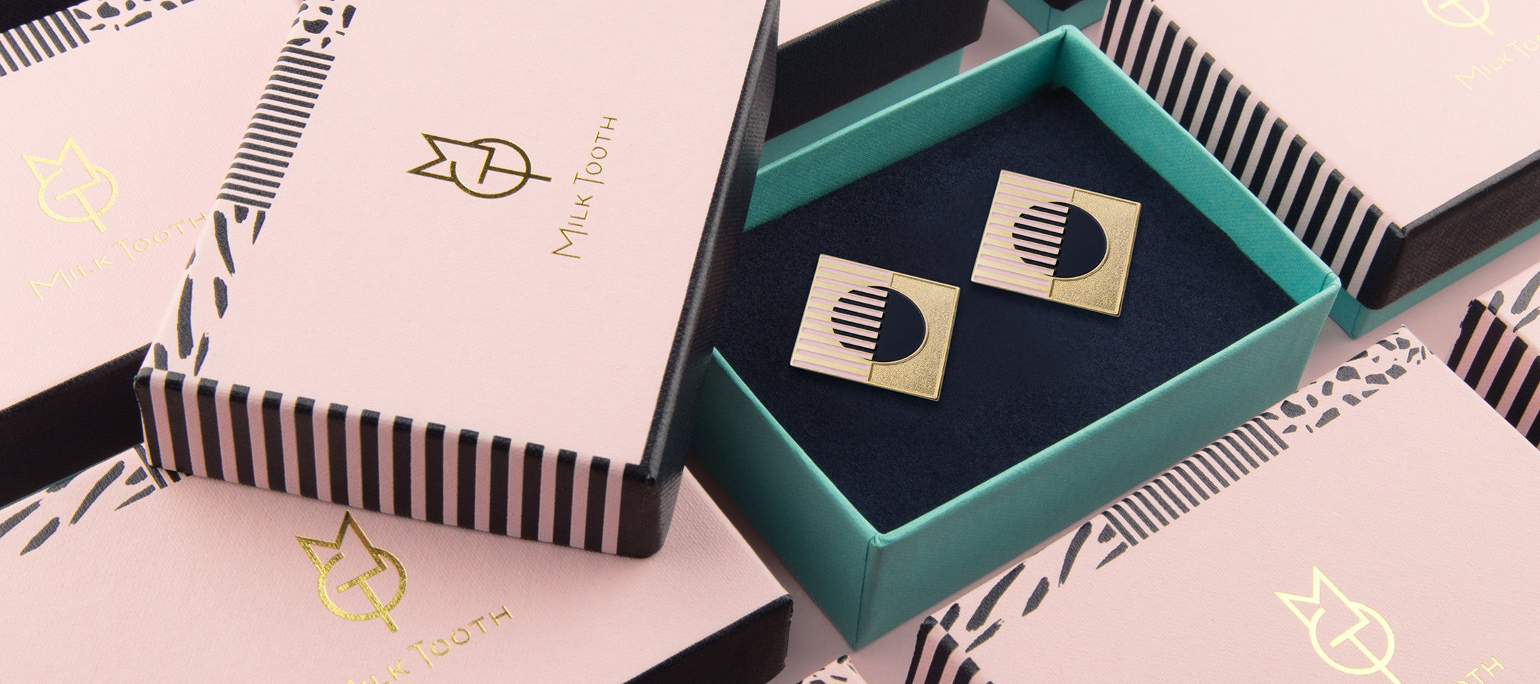 Milk Tooth London Earrings and packaging