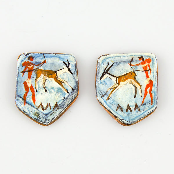 Caveman bow statement earrings