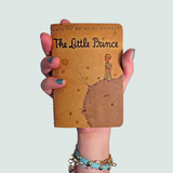 little prince pocket notebook in hand from manuscript notebooks
