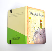 little prince hardcover notebook open face down from manuscript notebooks
