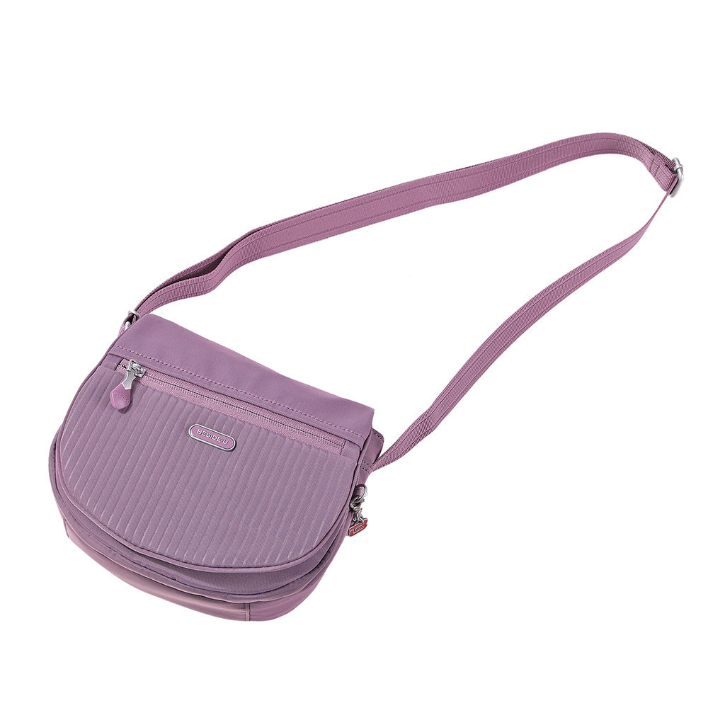 Crossbody Bag - Liv Debossed Crossbody Saddle Flap Bag Grapeade Purple Lying Down [Grapeade Purple]