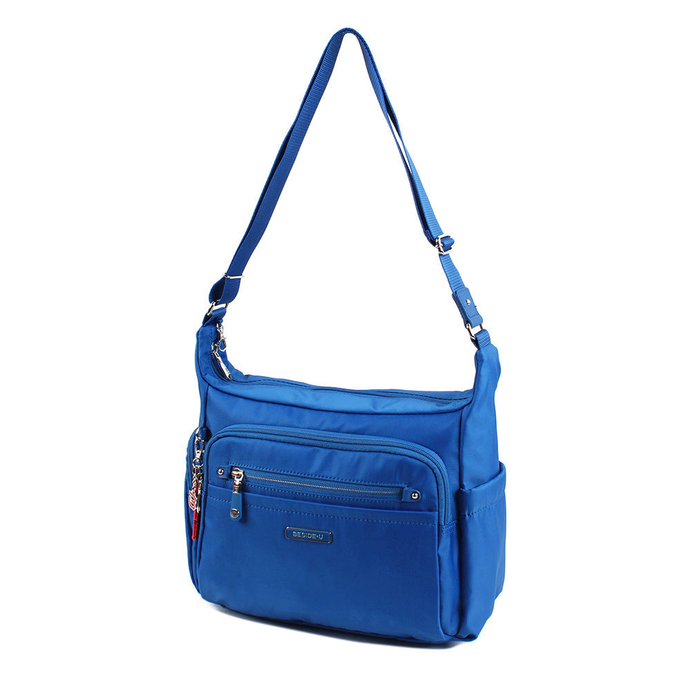 Crossbody Bag - Grenada Leather Trimmed Multi-Pocket Crossbody Bag With Red Whistle Angled [Strong Blue]